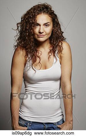 ad94f344c7793 Stock Photo of Portrait of woman in tank top is09ap6dg - Search ...