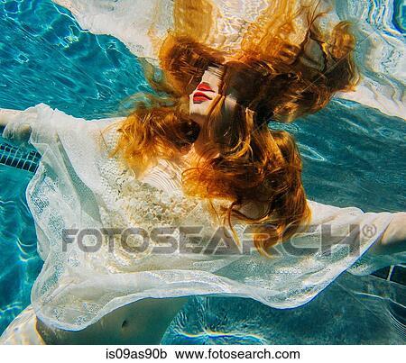 White Shirt Underwater Photos and Premium High Res