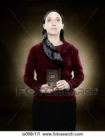 Portrait Of A Young Jewish Woman Holding A Prayer Book Stock Image