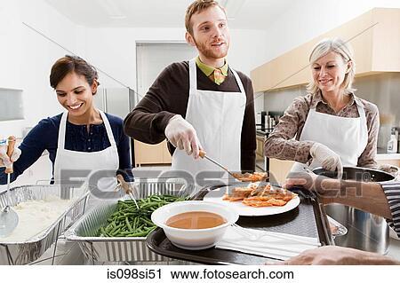 Elegant People Volunteering At Soup Kitchen