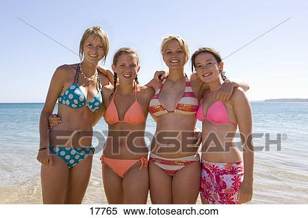 Stock Image - Teenage girls posing at beach. Fotosearch - Search Stock  Photos, Mural