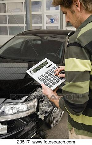 Insurance adjuster assessing damage to car Stock Photo ...