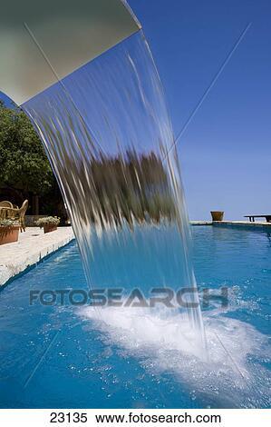 Swimming pool waterfall Stock Photography | 23135 | Fotosearch