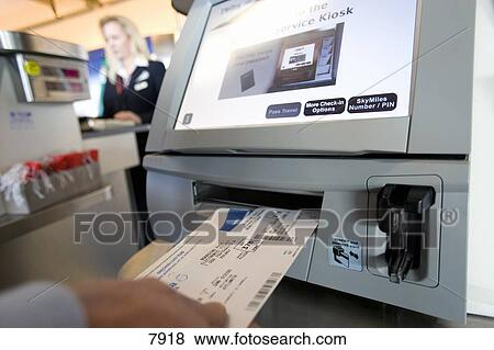 Pictures Of Traveller Placing Airline Ticket Into