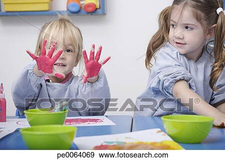 Girls Finger Painting In Classroom