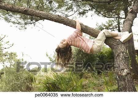 Girl Hanging Upside Down From a Tree Girl Hanging From Tree Branch