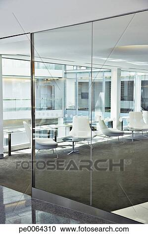 Chairs in modern office lobby Stock Image