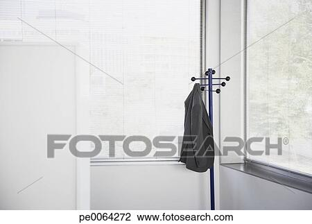 Stock Photo   Suit Jacket Hanging On Office Coat Rack. Fotosearch   Search  Stock Photography