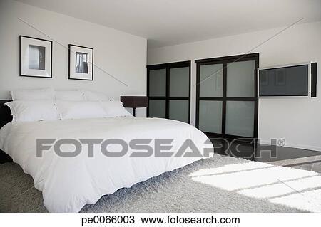 https://fscomps.fotosearch.com/compc/OJO/OJO206/binnenste-van-hippe-slaapkamer-stock-foto__pe0066003.jpg
