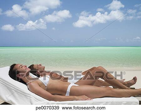 Sunbathing On Lounge Chairs