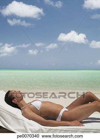 Lounge Chair On Beach Stock Image