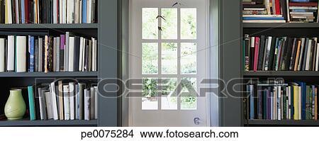 Stock Photo Of Doorway Set In Bookshelves Full Of Books Pe0075284
