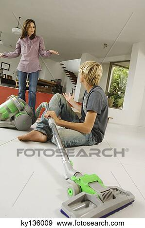 Stock Photograph Of Mother And Son In Living Room Vacuum Cleaner