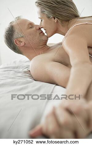 stock photo of couple romancing on the bed ky271052 search stock
