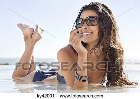 Beautiful Woman Lying On The Beach