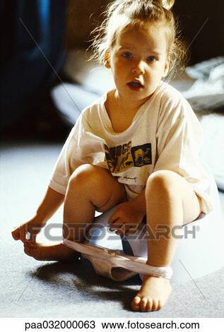 little girls underwear Cute little girl in underwear near white brick wall