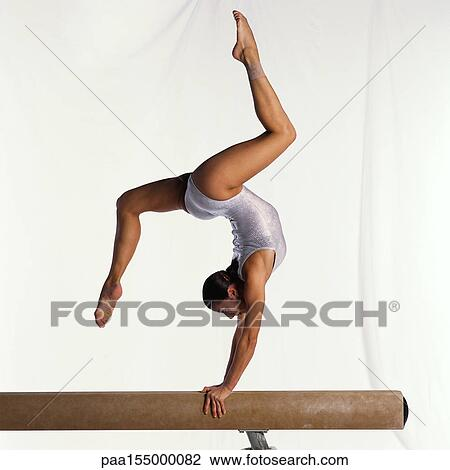 Stock Photo Of Young Female Gymnast On Balance Beam Performing Side