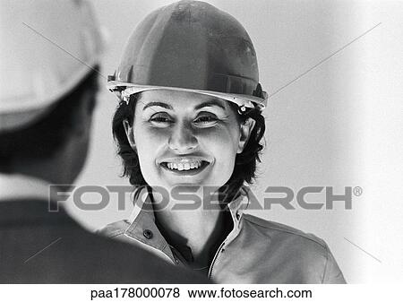 pictures of woman wearing hard hat smiling close up b w