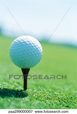 Golf Ball On Tee Close Up Stock Photo Paa299000007 Fotosearch