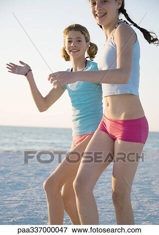 Picture Of Two Preteen Girls Running On Beach Paa337000047