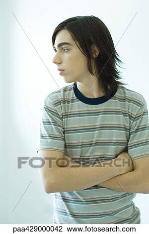 Teenage Boy Standing With Arms Crossed Stock Image