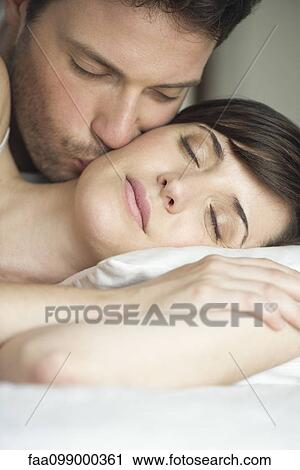 Stock Photography Of Couple Together In Bed Husband Kissing Wifes