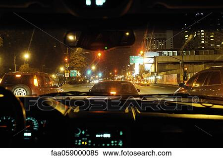 Congested City Street Viewed From Inside Car At Night