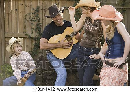 bd40b3fbd2b44 Family playing country music and dancing Stock Photo 1785r-1412
