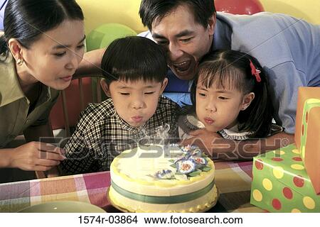 Terrific Son And Daughter Blowing Out Candles On Their Birthday Cake With Personalised Birthday Cards Cominlily Jamesorg
