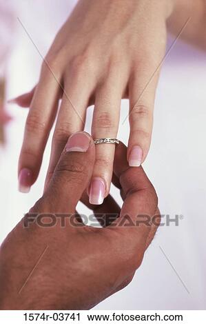 Stock Photography Of Man Putting On A Wedding Ring On A Woman S