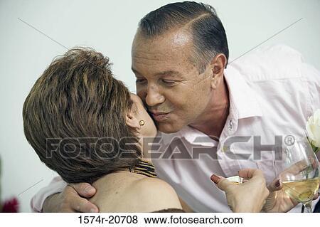 Mature women kissing each other