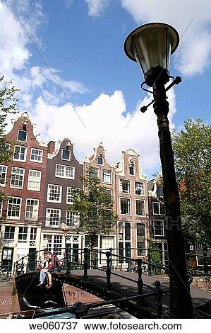 Old Dutch Houses Of Brouwersgracht And Street Light Amsterdam