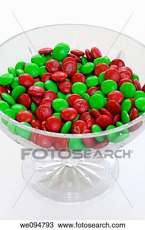 Christmas Candies.Green And Red Chocolate Christmas Candies In A Crystal Bowl On White Background Stock Image