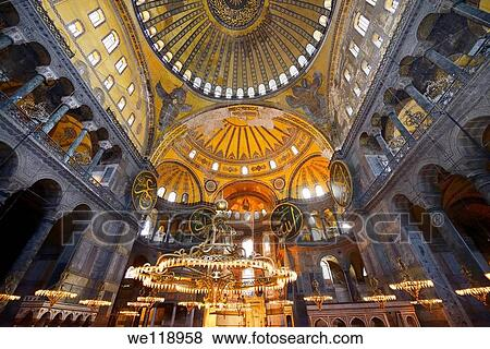 Pictures of ceiling domes and lit chandeliers with six winged ceiling domes and lit chandeliers with six winged saraphim in the hagia sophia istanbul aloadofball Images