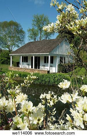 Stock images of whitewing farm bed and breakfast chester county whitewing farm bed and breakfast chester county kennett square pennsylvania white wooden cottage with azalea flowers mightylinksfo