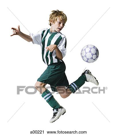 stock photography of young boy kicking a soccer ball a00221 search