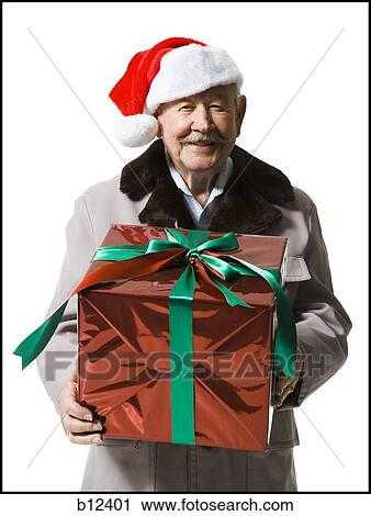 Stock Photography Of Older Man In Santa Hat Holding A Christmas
