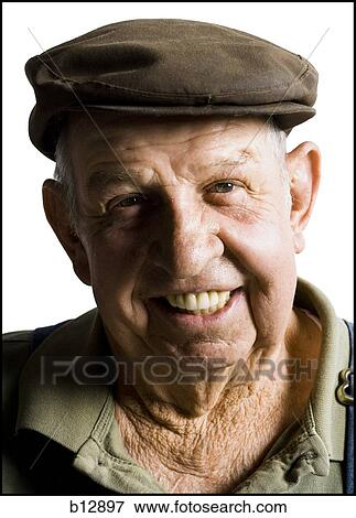 Picture of Older man wearing a flat cap b12897 - Search Stock ... ebc766b8020