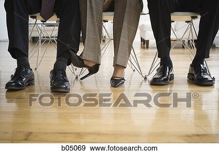 Stock Photo Businesswoman Caressing Businessman S Leg Under Table Fotosearch