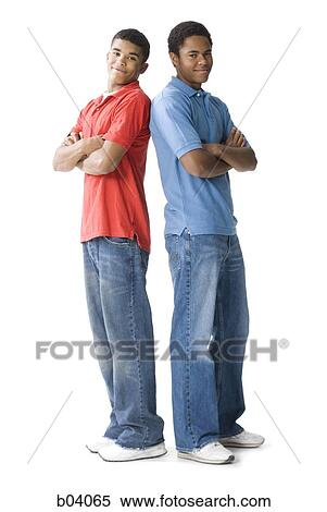 Teenage Boys Standing With Arms Crossed Stock Photography