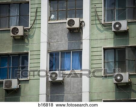 pictures of detailed view of windows in apartment building
