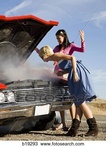 Stock Photo Two Women With A Broken Down Car Fotosearch Search Images