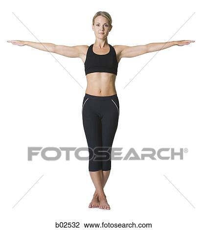 stock photo of portrait of a young woman standing with outstretched