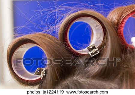Close up of hair in velcro rollers  Stock Photo