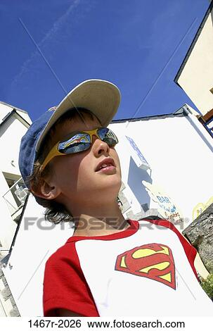 7a6b38c51850 People, hat, sunglasses, boy, outdoors, cap, looking Stock ...