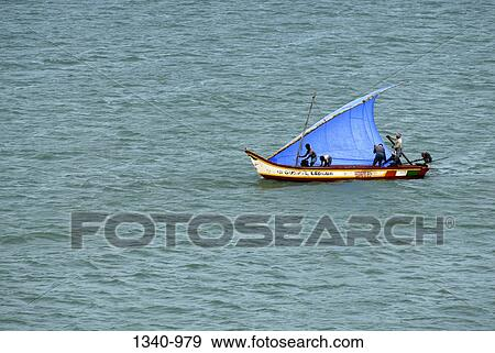 Stock photograph of fishing boat in the sea kanyakumari for Mural fish in tamil