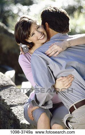 stock photography of people couple outdoors romantic hugging