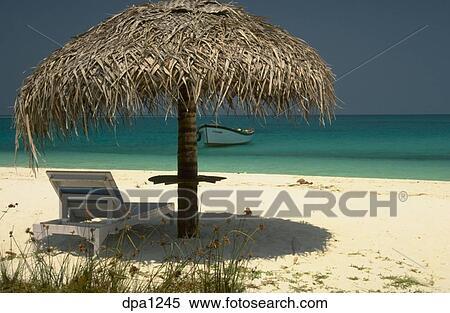 Sensational Grass Umbrella Over Beach Lounge Chair On White Sandy Beach Forskolin Free Trial Chair Design Images Forskolin Free Trialorg