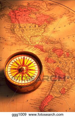 Stock Photograph Of Still Life Of A Compass Sitting On An Old Map Of