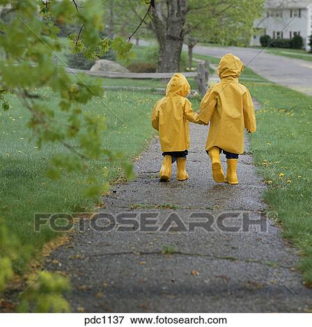 Walking in the rain holding hands